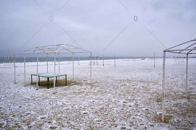 Empty winter beach with visible sea evaporations after a snow storm on the coast of Kamchiya reserve near Varna, Bulgaria