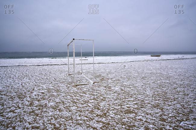 Snowfall on an empty winter beach with visible sea evaporations the coast of Kamchiya reserve near Varna, Bulgaria after a snow storm