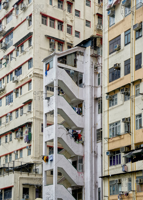 Hong Kong, China - February 1, 2018: Exterior of tall tenement composite buildings that were built in the 1950s and 1960s