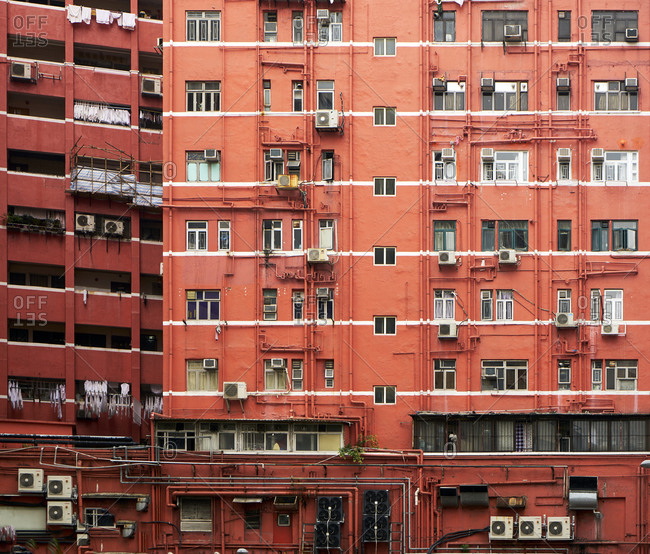 Hong Kong, China - February 1, 2018: Exterior of red tenement composite buildings that were built in the 1950s and 1960s