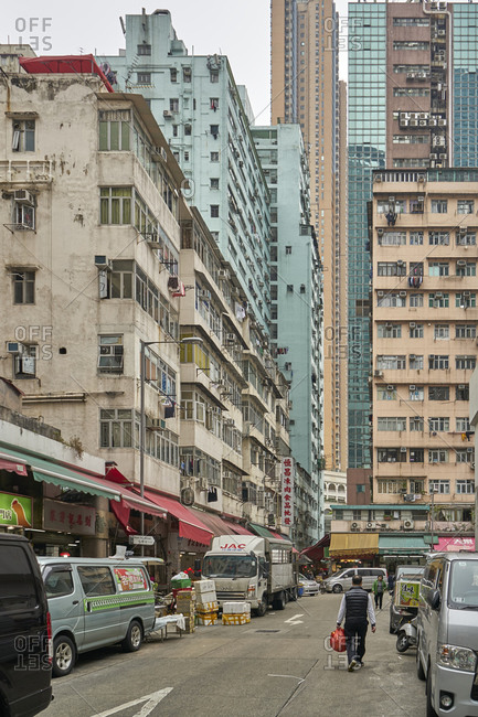 Hong Kong, China - February 1, 2018: A busy street with old residential apartment blocks visible in the background