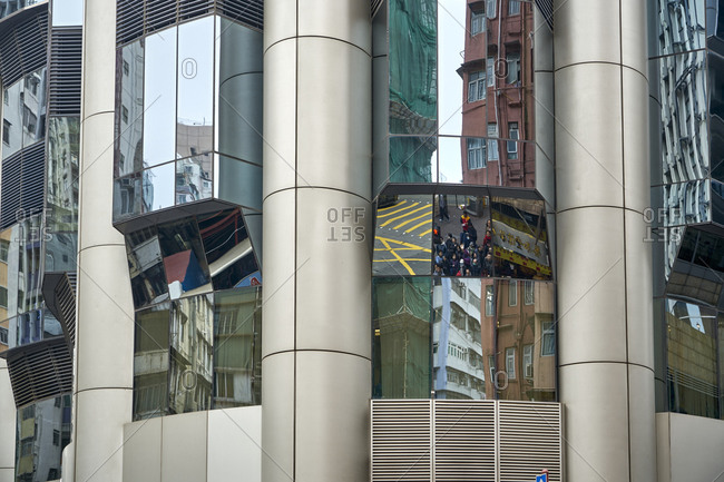 Hong Kong, China - February 1, 2018: A modern facade with street reflections in the central district of Hong Kong
