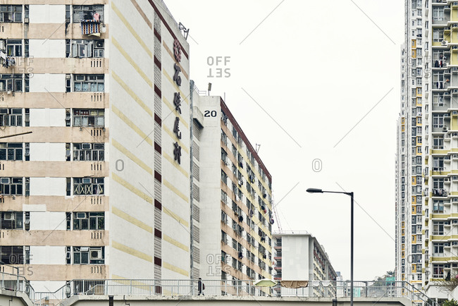 Hong Kong, China - February 1, 2018: A pedestrian passage among old residential apartment blocks in downtown Hong Kong that were built in the 1950s and 1960s can