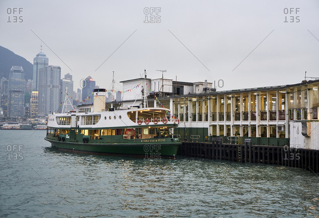 Hong Kong, China - February 1, 2018: The Star Ferry passenger ferry moored at pier on the coast of Hong Kong island