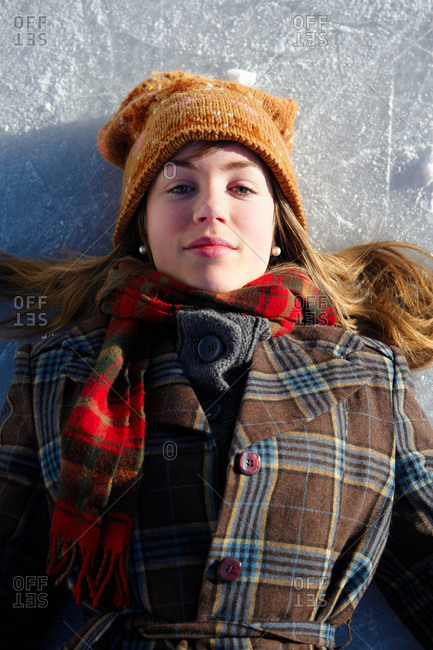 Portrait of teenage girl lying on ice