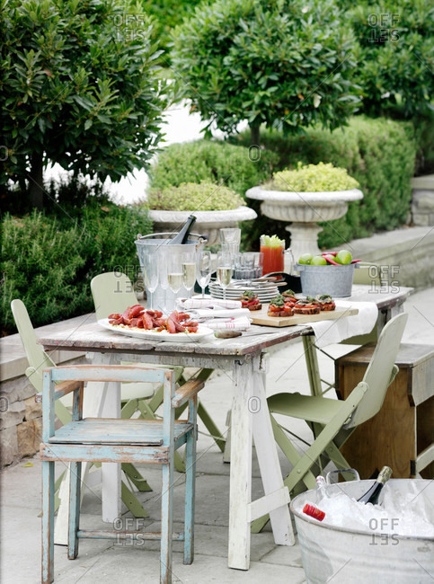 Table laid with food outdoors