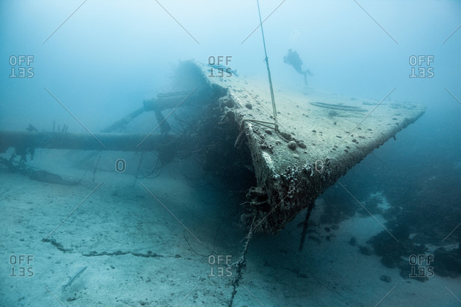 Diver examining an underwater shipwreck