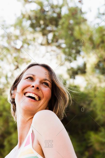 Smiling blonde woman walking outdoors