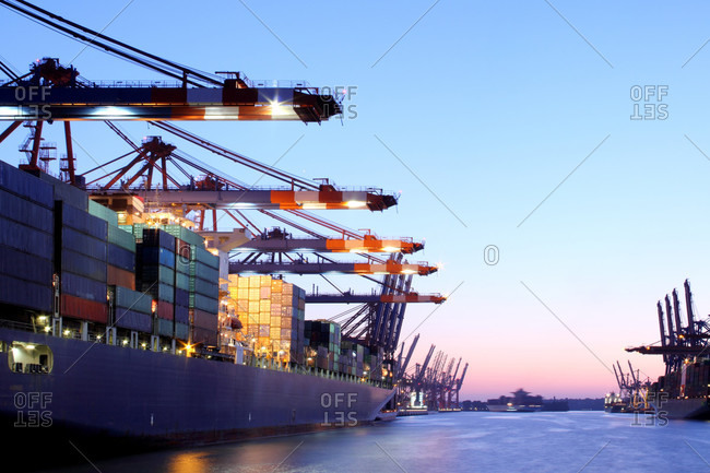 Container ship in urban harbor