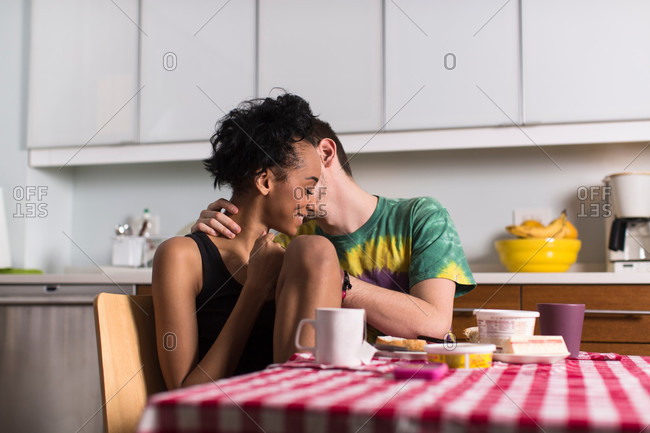 Young couple having breakfast together