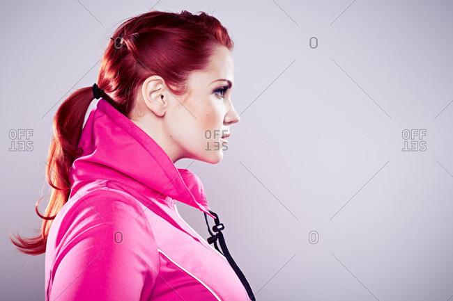 Young woman wearing pink top, side view