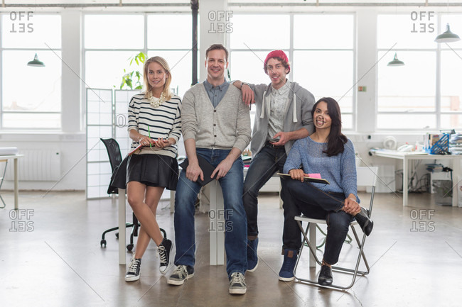 Creative business team sitting together in office, portrait