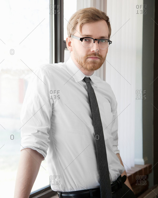 Portrait of young man wearing spectacles and tie