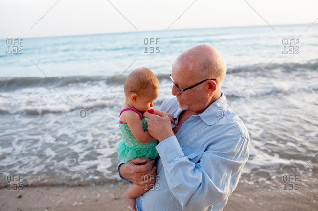 Grandfather with granddaughter on beach, St Maarten, Netherlands