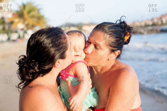 Grandmother, daughter and baby granddaughter on beach, St Maarten, Netherlands