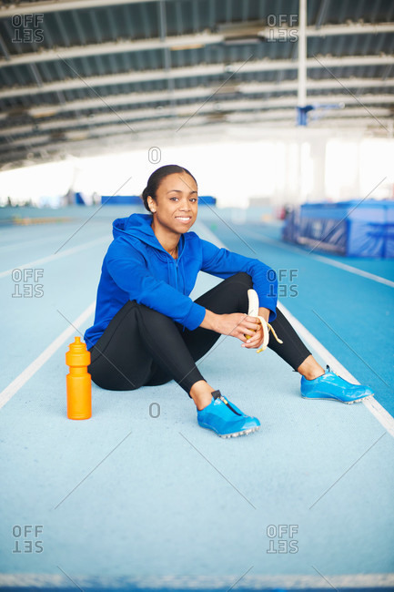 Portrait of young female athlete resting