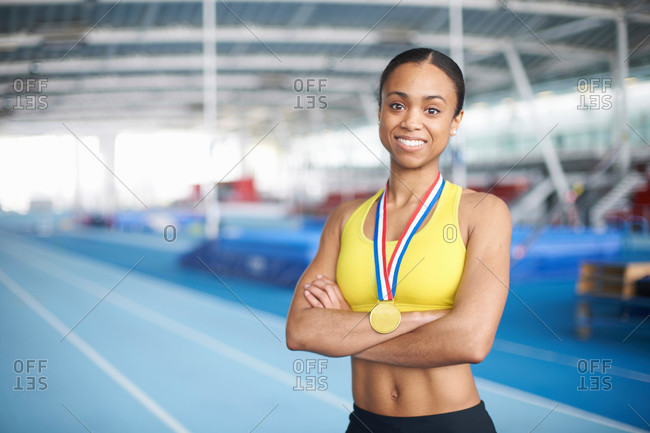 Young female athlete wearing gold medal