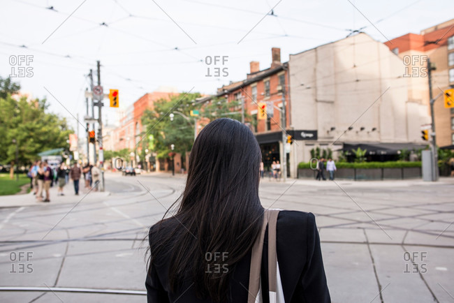 Rear view of woman standing in Toronto