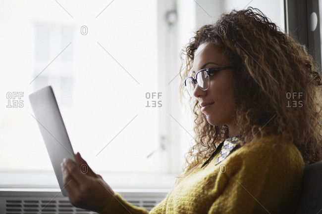 Female office worker using digital tablet