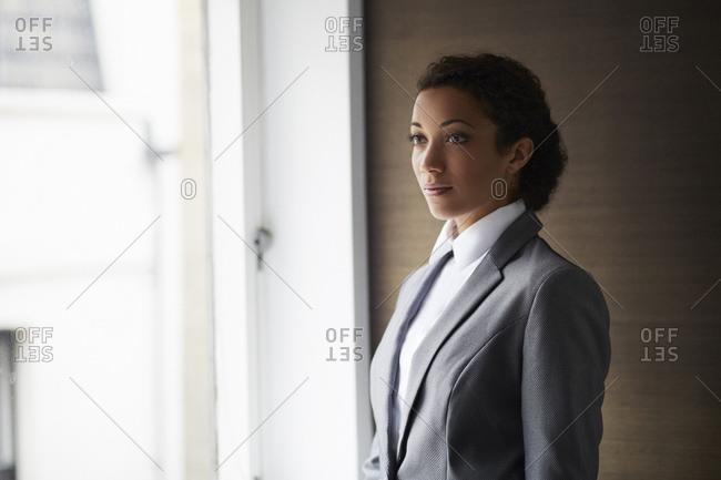 Portrait of businesswoman by window
