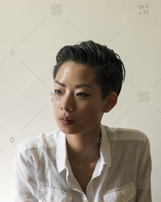 Studio shot of young woman with short hair