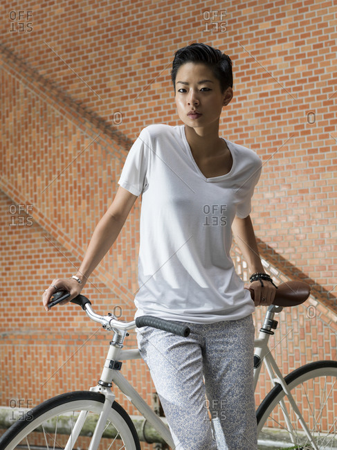 Young woman with fixed gear bicycle