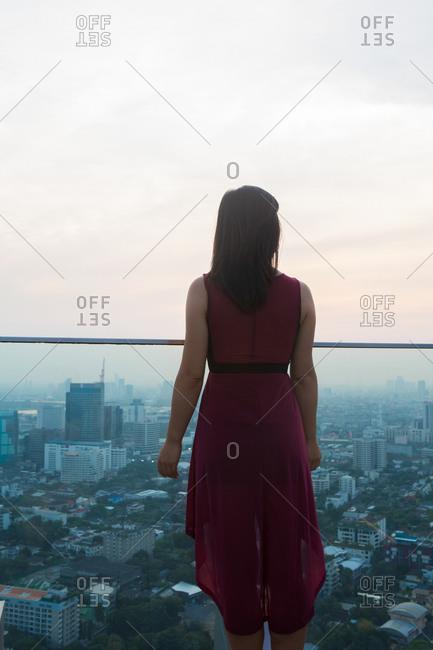 Woman on balcony, Bangkok, Thailand