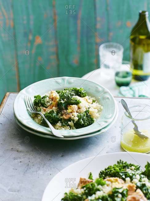 Plates of salmon, quinoa and kale salad