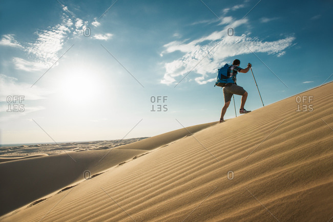 Man hiking in Glamis sand dunes, California, USA