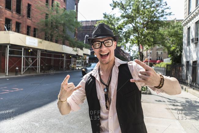 Funky man in street, New York City, US