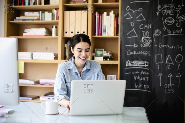 Graphic designer using laptop at work
