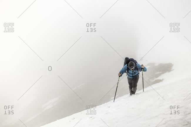 Man mountain trekking in mist, Bavarian Alps, Oberstdorf, Bavaria, Germany