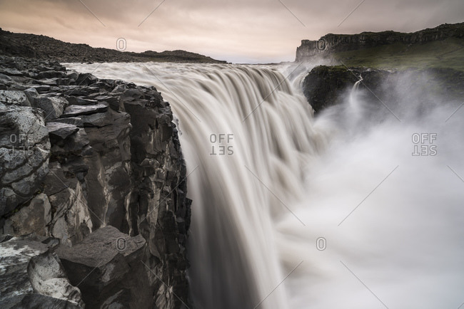 Dettifoss waterfall in pink evening glow, North Iceland