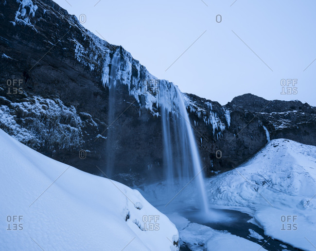 Seljalandsfoss waterfall in winter twilight, South Iceland