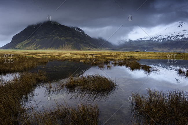 Pond in Sudursveit, Austur-Skaftafellssysla, Mount Fellsfjall in background, Southeast Iceland