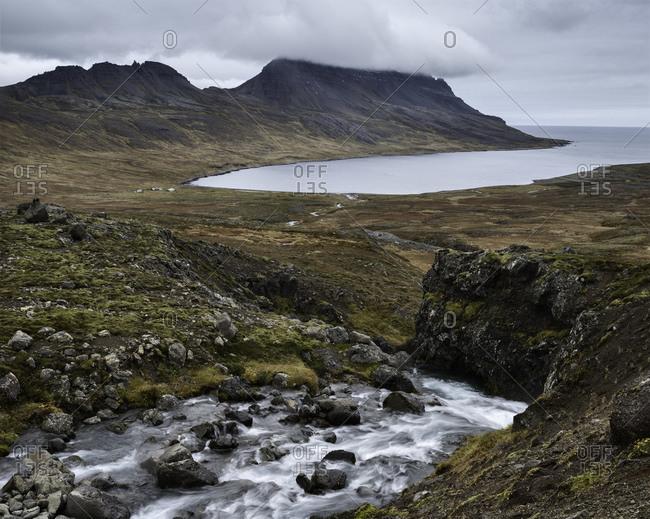 River flowing down into fiord Veidileysufjordur, Strandir, Iceland