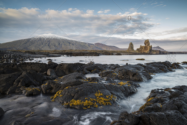 Seascape by Malarif, Londrangar sea stacks and Snaefellsjokull glacier in background, Snaefellsnes, Iceland