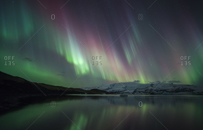 Northern lights dancing over Jokulsarlon glacial lagoon, Southeast Iceland