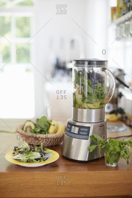 Blender full of greens for smoothie