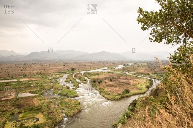 Elevated view of landscape of Lake Kivu and misty mountains, Rwanda, Africa