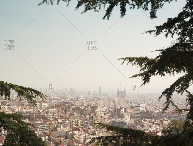 High angle cityscape with Sagrada Familia on skyline, Barcelona, Spain