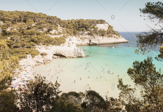 High angle view of tourists at beach, Cala Galdana, Menorca, Balearic Islands, Spain