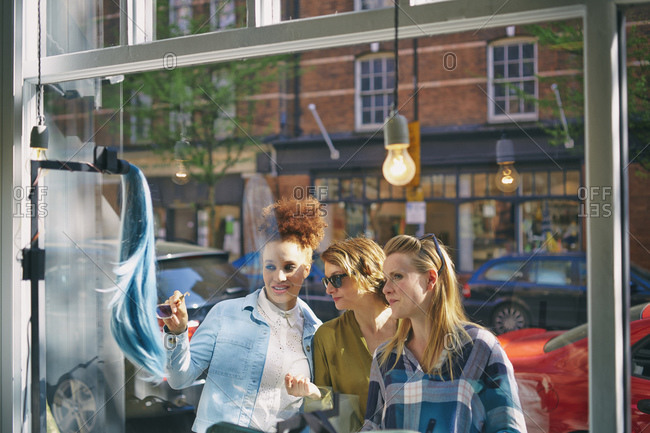 View through glass of women looking in shop window