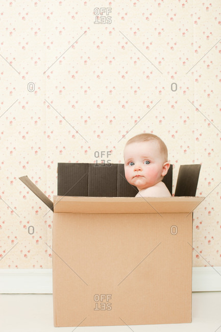 Baby girl in a cardboard box