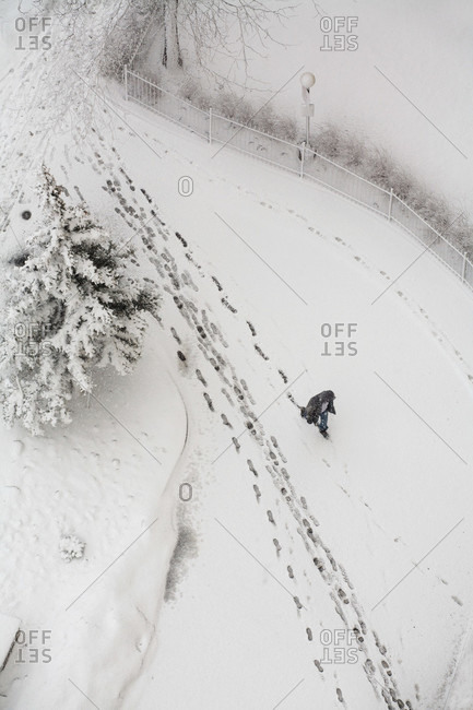 Top view of person trekking through the snow