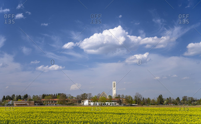 Germany, bavaria, upper bavaria, munich district, oberhaching, deisenhofen district, rapsfeld with st. bartholomew's church and primary school