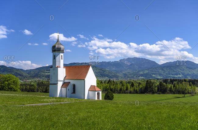 Germany, bavaria, upper bavaria, pfaffenwinkel, penzberg, sankt johannisrain district, sankt johannisrain church against prealps with benediktenwand