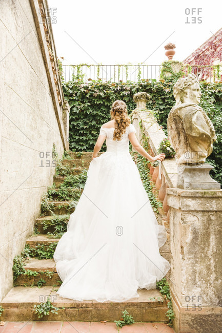 Bride, wedding, garden, young woman, wedding dress, climbing stairs, back view