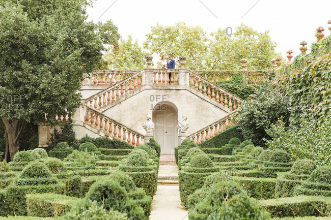 Wedding, newlyweds, young adults, diversity, garden, landing, symmetrical