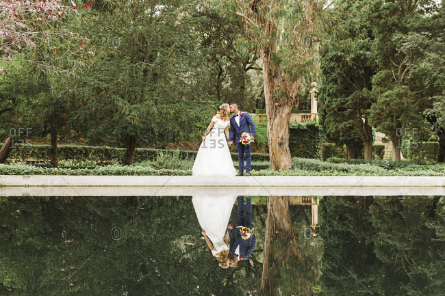 Wedding, newlyweds, young adults, diversity, love, park, reflection